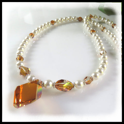 Exquisite Swarovski crystal copper crystals and white pearls necklace.