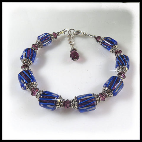 Blue and purple David Christensen glass beaded bracelet with amethyst crystals.