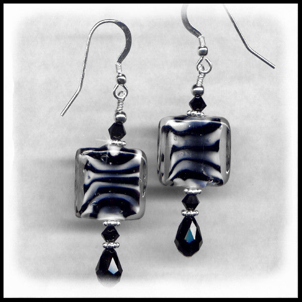 Zebra beaded earrings with black Swarovski crystals.