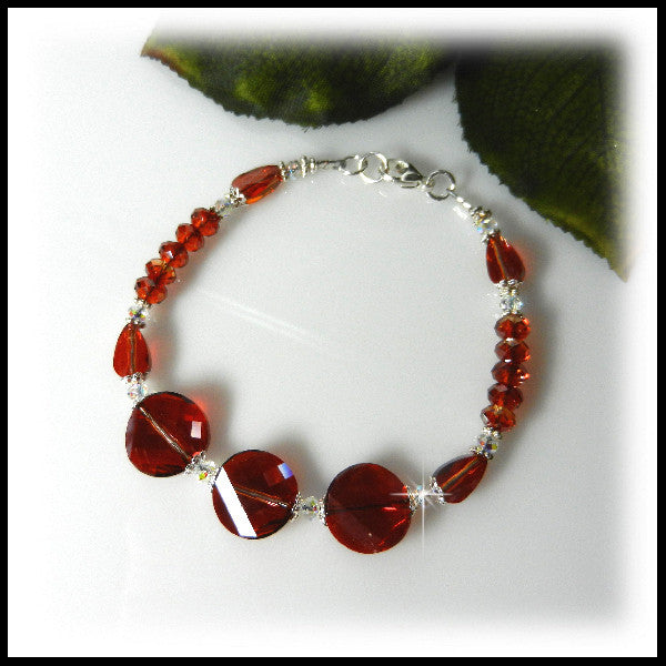 Red Magma Swarovski crystal beaded bracelet with three crystal twist coins.