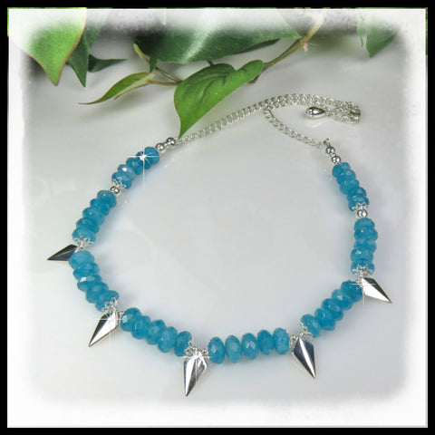 Zambian Aquamarine rondelles with sterling silver shield spikes.