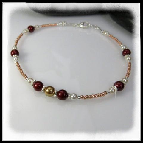 Burgundy, bright gold and white Swarovski pearls and gold seed beads in this beaded anklet