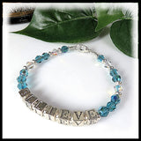 "Inspirational bracelet with ""Believe"" in sterling silver and crystals."