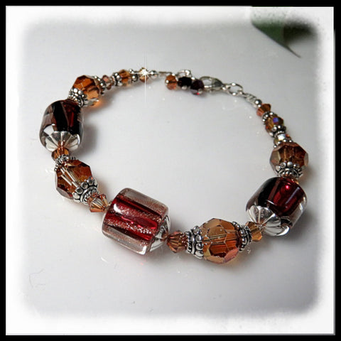 Deep red David Christensen glass and crystal copper crystals in this bracelet