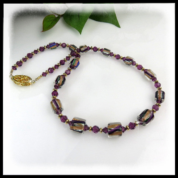David Christensen glass beaded necklace with amethyst Swarovski crystals and gold filled beads and clasp.