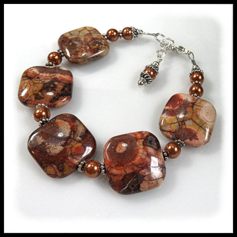 Birdseye Rhyolite beaded bracelet of browns, burgundys and gold colors.