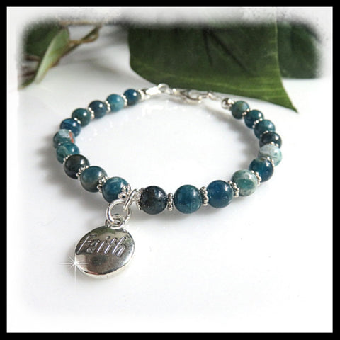 Teal blue Apatite bracelet with a sterling silver faith charm.