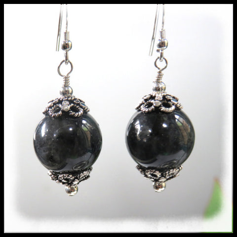 Larvite gemstone earrings set in antique bali silver bead caps.