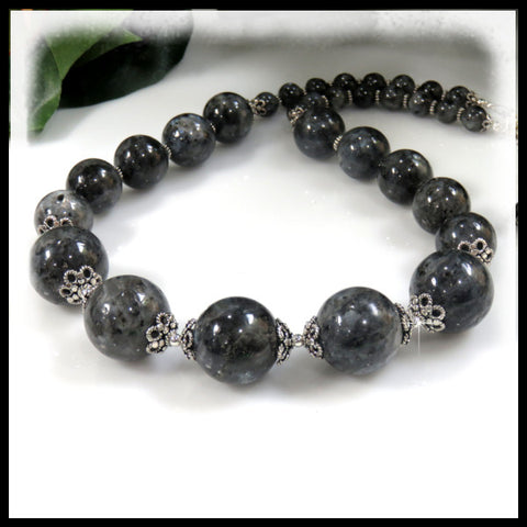 Chunky beaded necklace of gray Larvite gemstones.