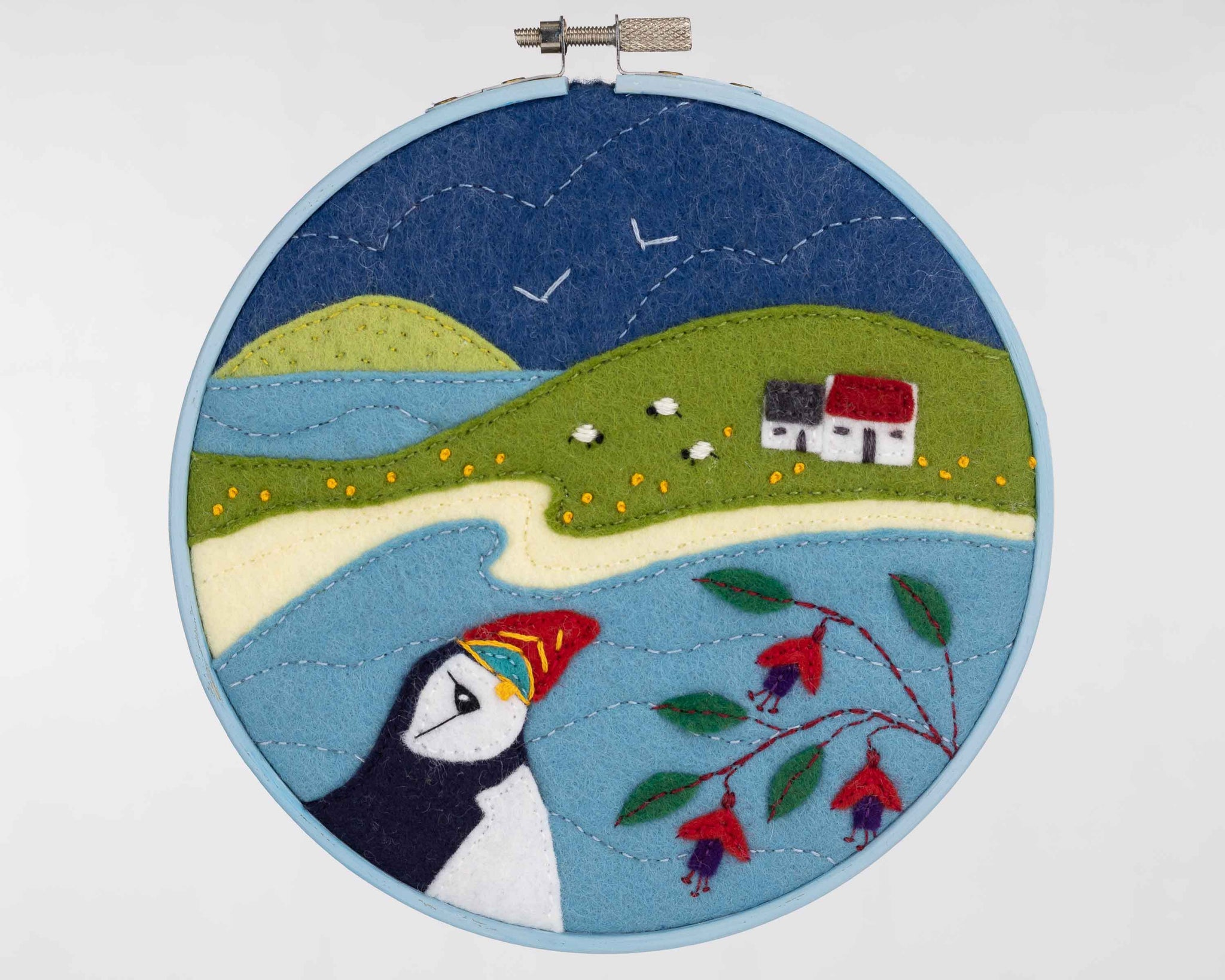 Hoop framed puffin embroidery, Puffin Cottage