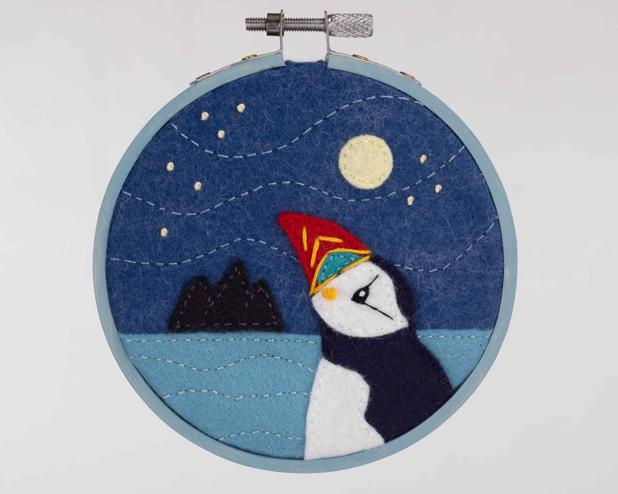 Moon gazing puffin framed embroidery