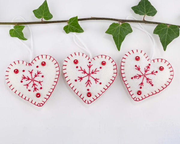 Snowflake heart Christmas ornaments in dark red and white