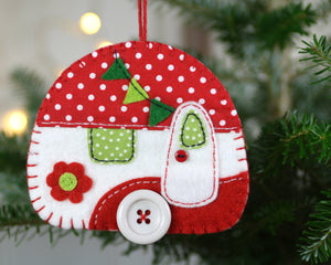Large camper Christmas ornament in red and white