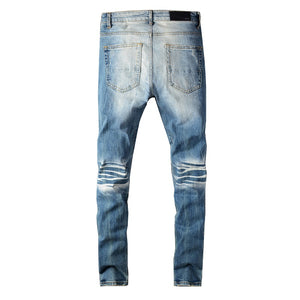 AMIRI LEO PATCH DESTROYED DENIM - BLUE