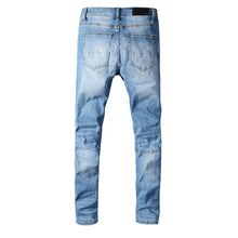 Load image into Gallery viewer, AMRI DESTROYED TIE DYE PATCH JEAN - BLUE