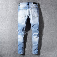 Load image into Gallery viewer, AMRI KNEE OUT DENIM