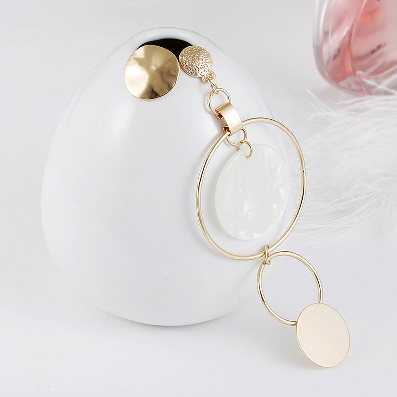 Asymmetric Hollow Round Loop Earrings - Toyzor.com