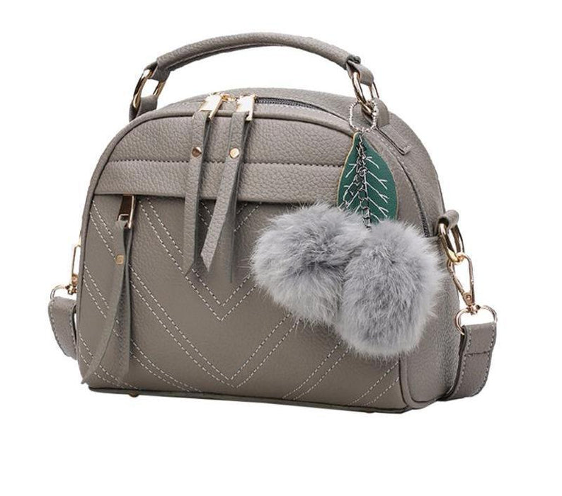 Leather Messenger Handbag With Ball Toy