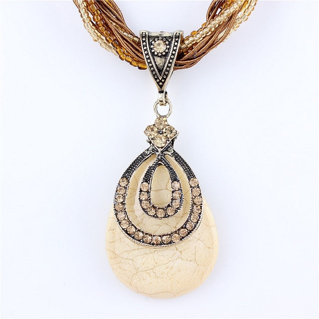Natural crystal stone pendant - Multiple Designs and Colors
