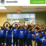 Deca Middle School showing off their new t-shirts their class got. We designed and printed these shirts.