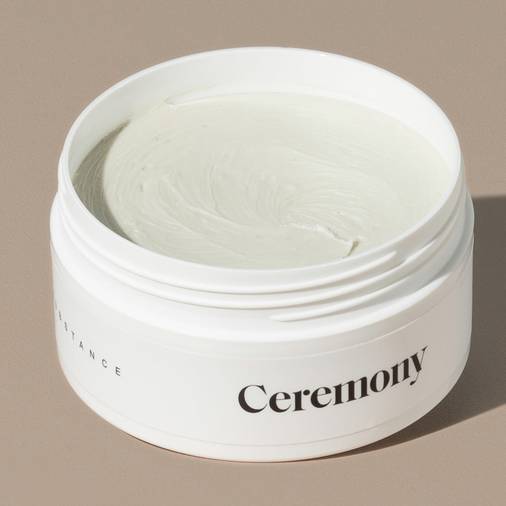 Ceremony substance hair shaping clay in a white round plastic container with minimalist black labeling