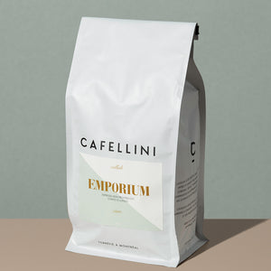 Emporium Espresso Blend by Cafellini tall rectangular white coffee bag with a light green labeling and gold inscriptions