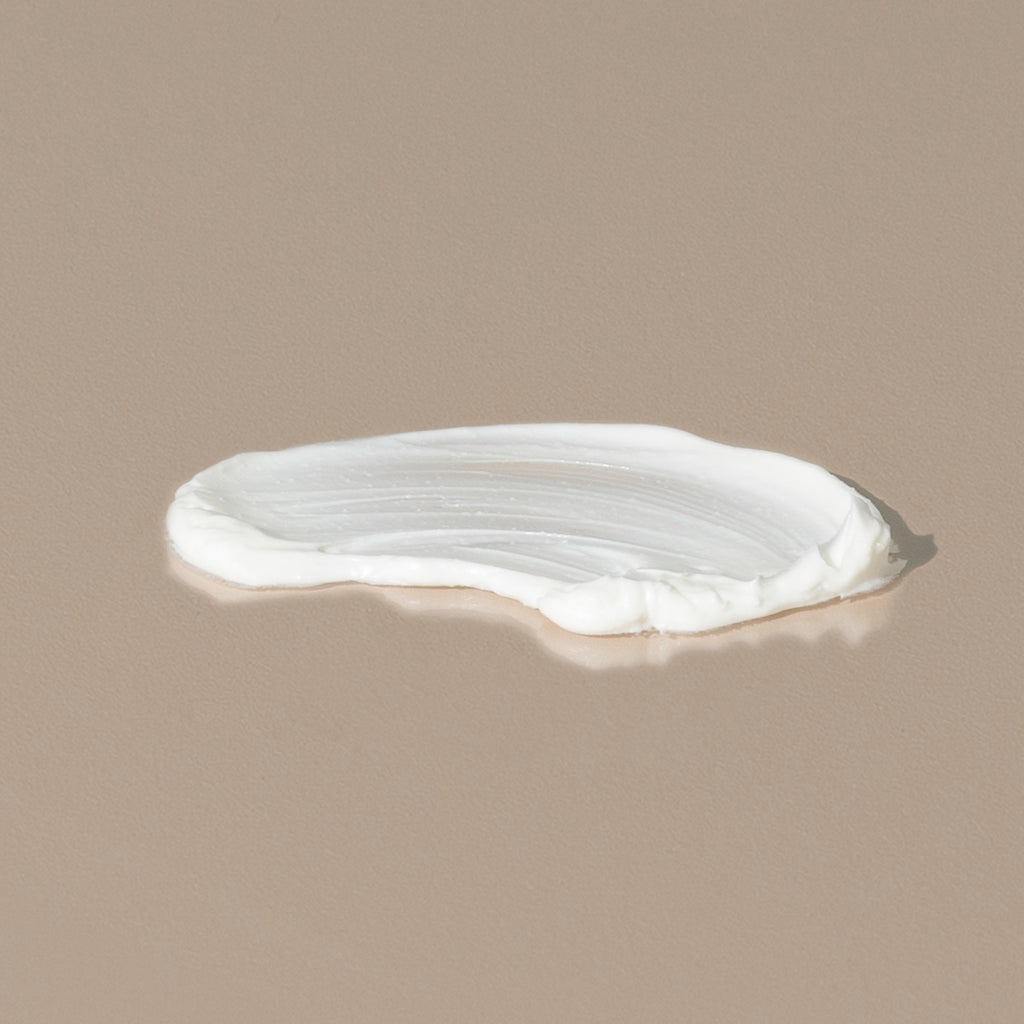 Groom aftershave balm spread of a white creamy texture on a table