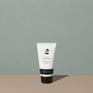 Groom aftershave balm in a white plastic squeeze tube with a black and white label of a mustache man