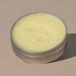 view inside yellow wax creamy Groom beard balm citrus in a rounded metal packaging