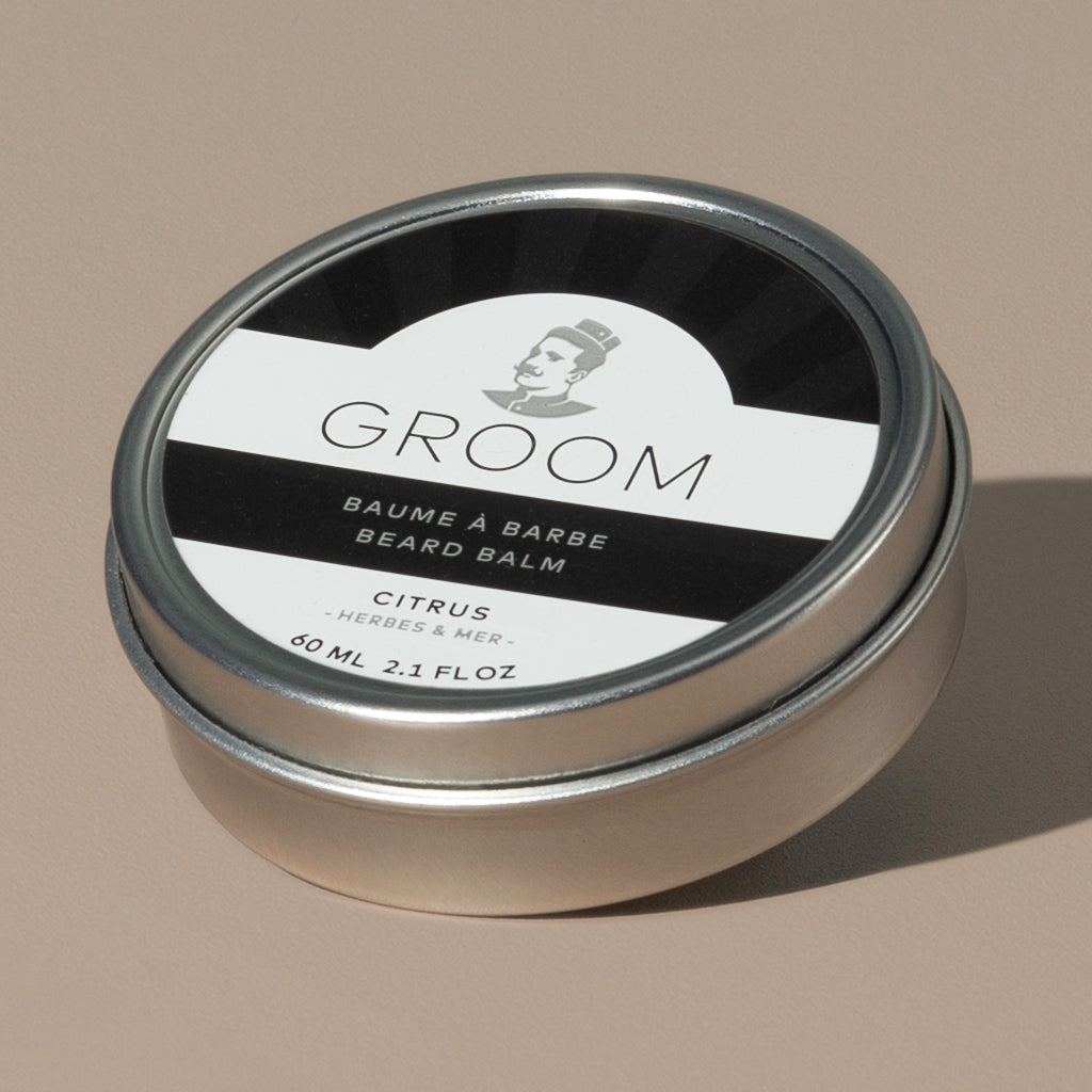 Groom beard balm citrus in a rounded metal packaging with a black and white label of a mustache man