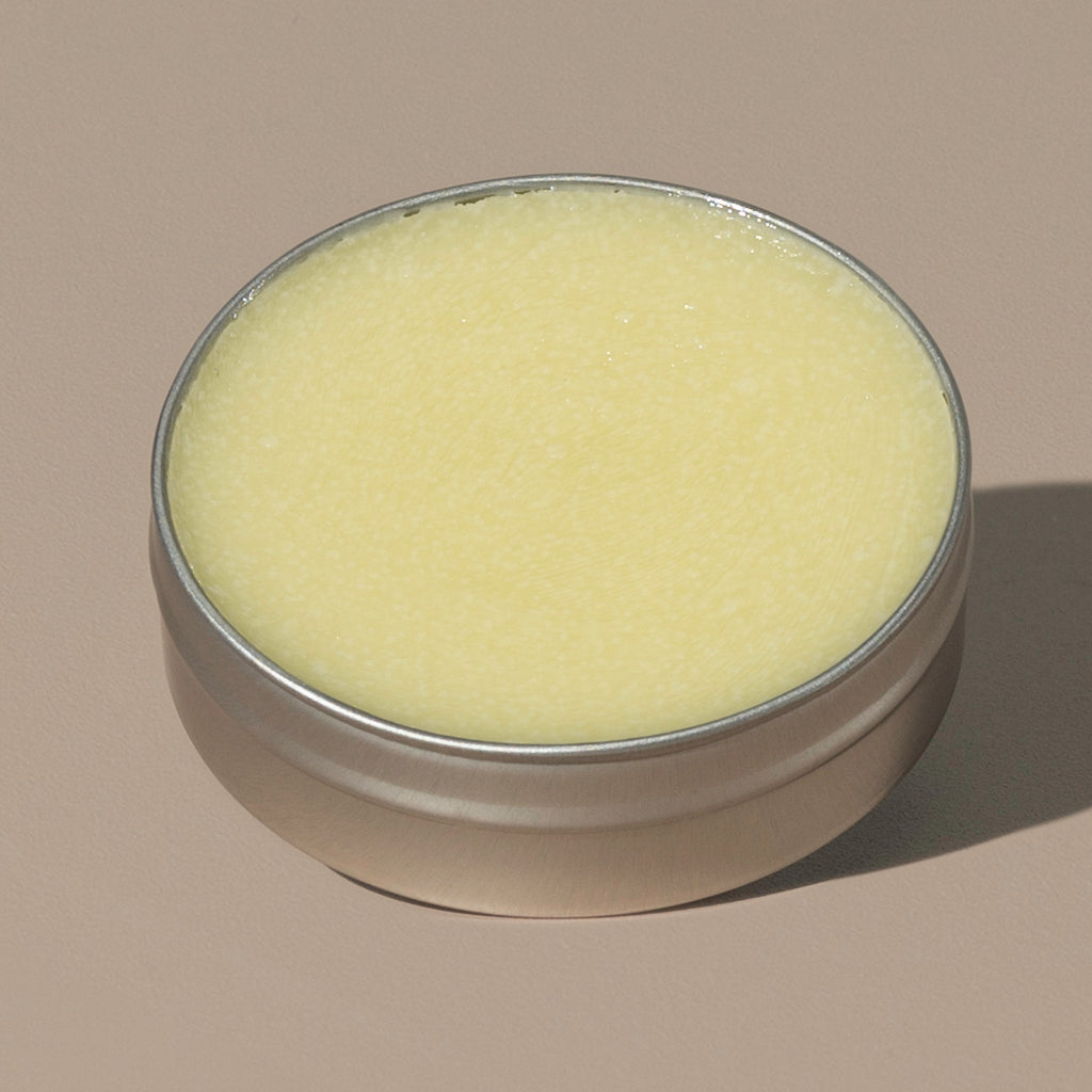 view inside yellow wax creamy Groom beard balm original in a rounded metal packaging