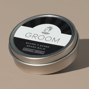 Groom beard balm original in a rounded metal packaging with a black and white label of a mustache man