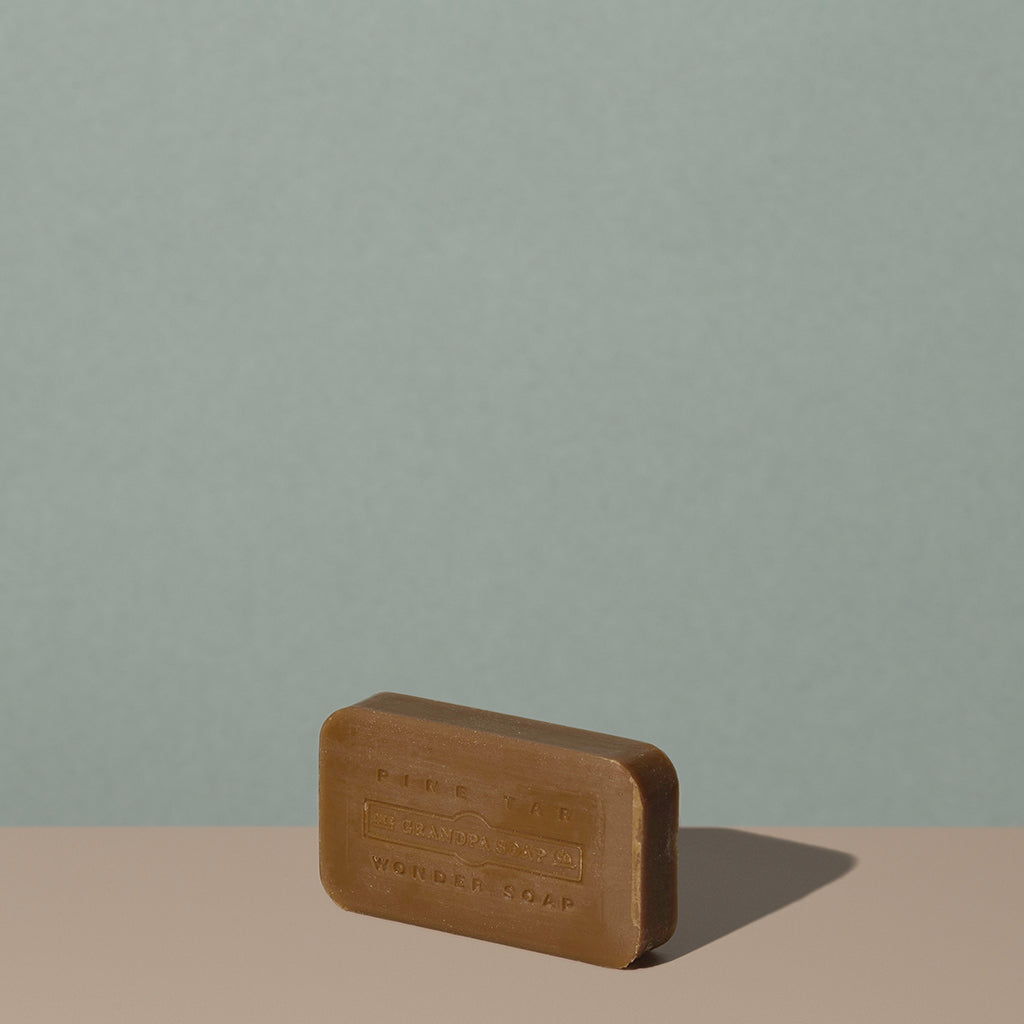 Out of the box The Grandpa Soap Co. brown rounded rectangle bar soap with embossed logo