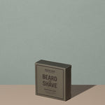 Hudson Made co beard and shave soap cedar clove in a square rectangle gray cardboard packaging with black writings