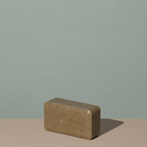 Out of the box Hudson Made co morning shift exfoliating brown rectangle body bar soap with embossed logo