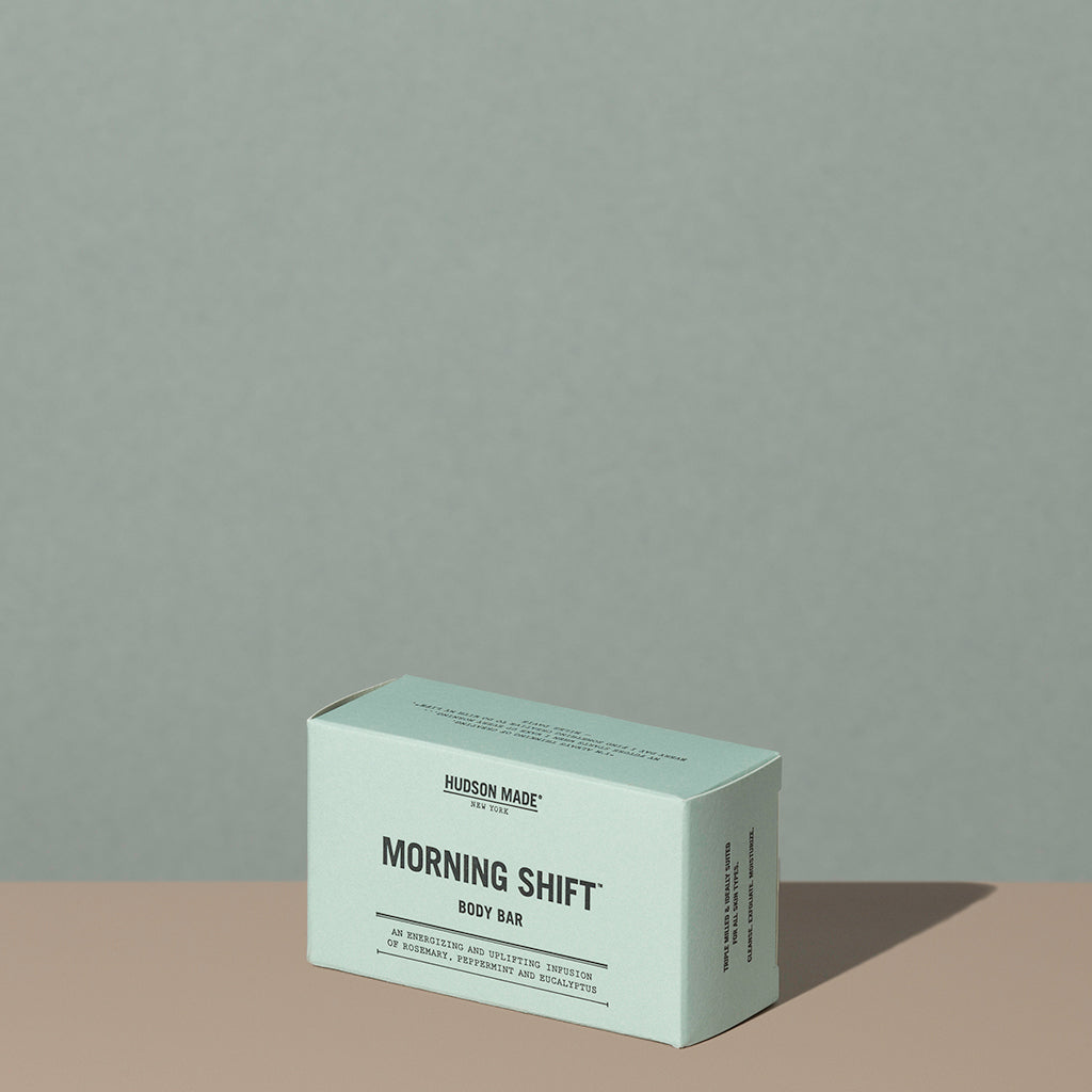 Hudson Made co morning shift exfoliating body bar soap in a rectangle green cardboard packaging with black writings