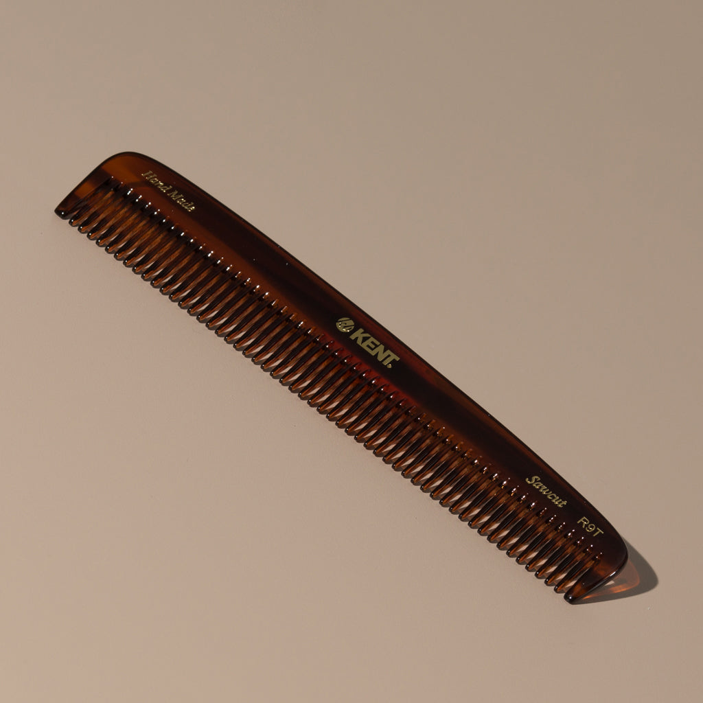 Kent tortoise large coarse handcrafted acetate rounded tooth comb for hair or beard with gold label on a table