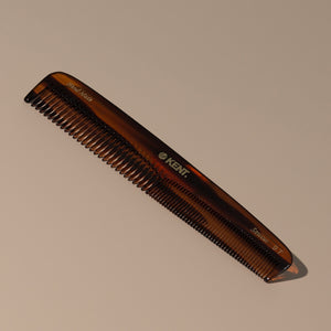 Kent tortoise fine coarse handcrafted 190mm acetate rounded tooth comb for hair or beard with gold label on a table