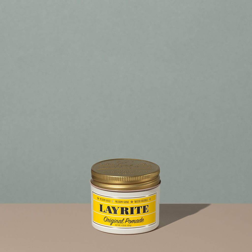 Layrite 4.25oz Original Pomade Medium Hold & Medium Shine hair pomade in a rounded white plastic container with gold twist cap and yellow label
