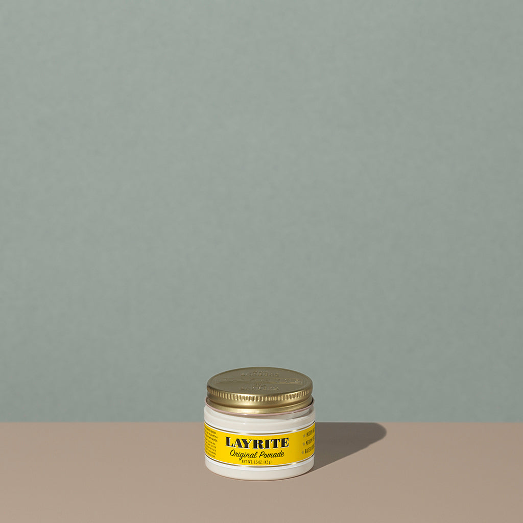 Layrite 1.5oz Original Pomade Medium Hold & Medium Shine hair pomade in a rounded white plastic container with gold twist cap and yellow label