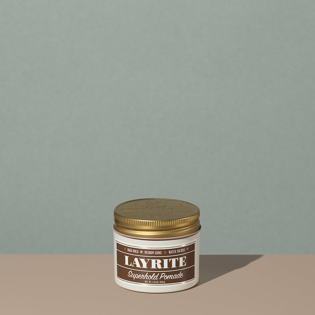 Layrite 4.25oz Superhold Pomade - High Hold & Medium Shine hair pomade in a rounded white plastic container with gold twist cap and brown label