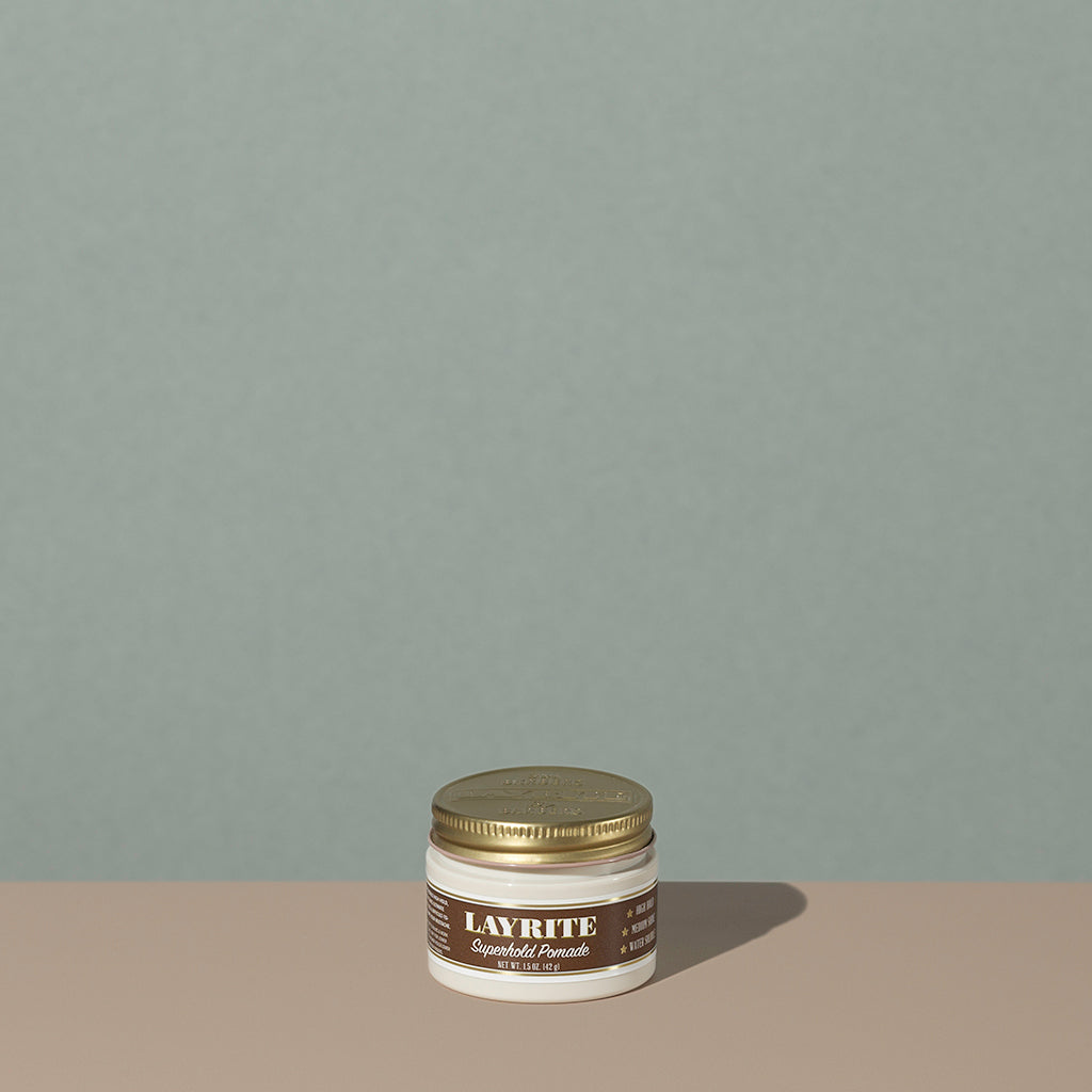 Layrite 1.5oz Superhold Pomade - High Hold & Medium Shine hair pomade in a rounded white plastic container with gold twist cap and brown label