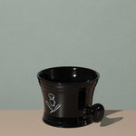 Pure badger shaving porcelain shaving mug with handle in black with a white logo