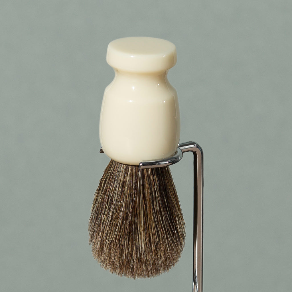 Close up details of Pure badger shaving cream Badger brush stand in chrome stainless steel with round base and rounded head