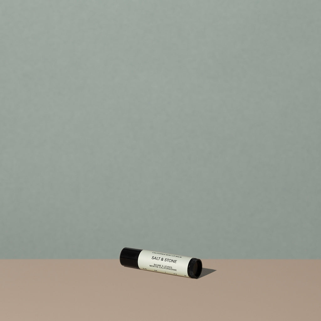 Salt & Stone mint lipstick balm in a small cylindric black lipstick packaging with a black cap and off white labeling with black writings