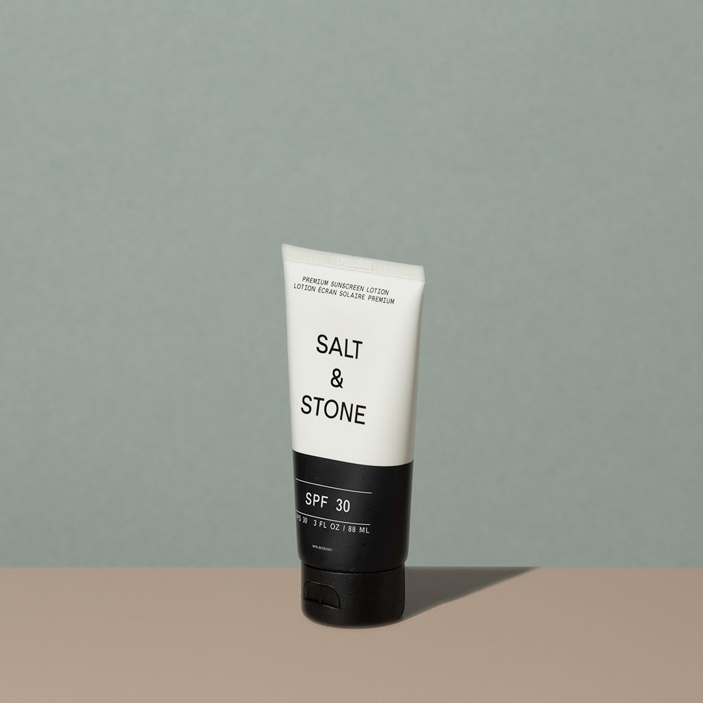 Salt & Stone sunscreen Lotion FPS 30 in a half black half white recycled plastic tube with a flip it black dispenser cap and black and white writings