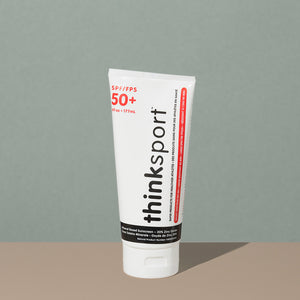 Thinksport 50+ FPS 6oz sunscreen in a white plastic tube with flip dispenser cap and black and red writings