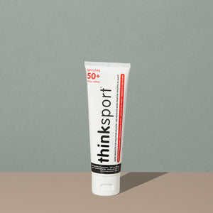 Thinksport 50+ FPS 3oz sunscreen in a white plastic tube with flip dispenser cap and black and red writings