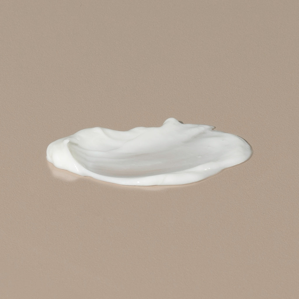 The Unscented Company Plant based hydrating lotion white creamy texture spread on a table