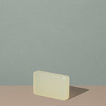 Off white beige rectangular soap bar of The Unscented Company biodegradable Soap Bar out of the box